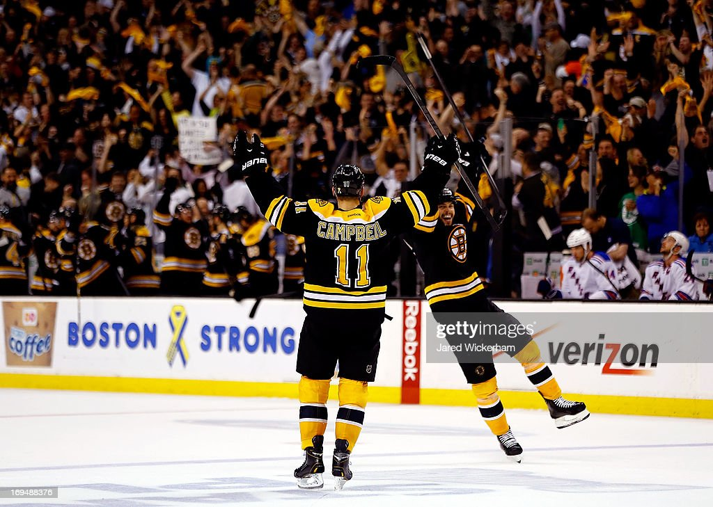 Gregory Campbell of the Boston Bruins celebrates an empty net goal in the third period against the New York Rangers during Game Five of the Eastern...