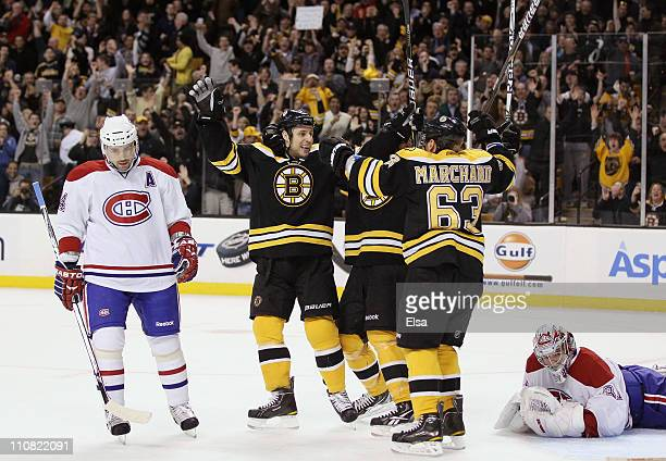 Gregory Campbell of the Boston Bruins celebrates his goal with teammate Brad Marchand as Carey Price and Tomas Plekanec of the Montreal Canadiens...