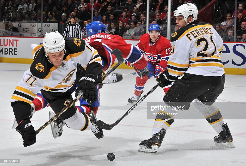 <a gi-track='captionPersonalityLinkClicked' href=/galleries/search?phrase=Gregory+Campbell&family=editorial&specificpeople=640895 ng-click='$event.stopPropagation()'>Gregory Campbell</a> #11 of the Boston Bruins collides with <a gi-track='captionPersonalityLinkClicked' href=/galleries/search?phrase=David+Desharnais&family=editorial&specificpeople=4084305 ng-click='$event.stopPropagation()'>David Desharnais</a> #51 of the Montreal Canadiens during the NHL game on October 29, 2011 at the Bell Centre in Montreal, Quebec, Canada.