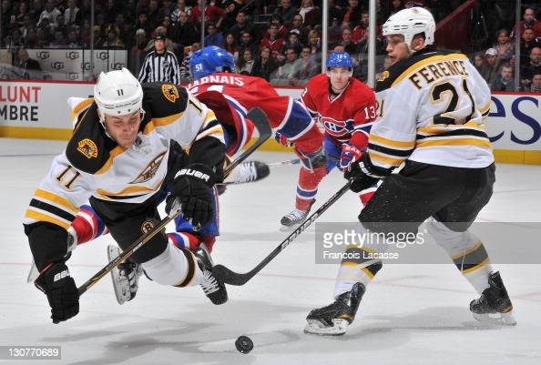 Gregory Campbell of the Boston Bruins collides with David Desharnais of the Montreal Canadiens during the NHL game on October 29 2011 at the Bell...