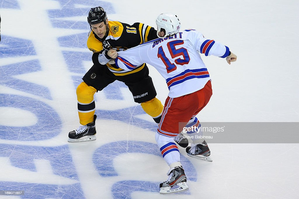 Gregory Campbell #11 of the Boston Bruins fights against Derek Dorsett #15 of the New York Rangers in Game Two of the Eastern Conference Semifinals during the 2013 NHL Stanley Cup Playoffs at TD Garden on May 19, 2013 in Boston, Massachusetts.