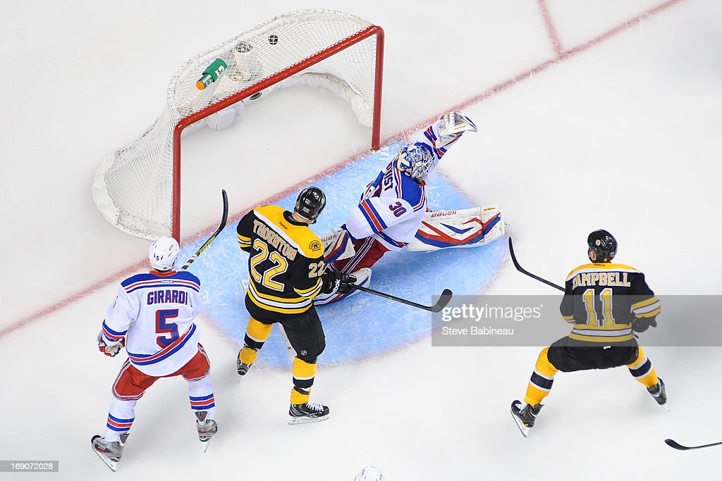 Gregory Campbell #11 of the Boston Bruins scores a goal against Henrik Lundqvist #30 of the New York Rangers in Game Two of the Eastern Conference Semifinals during the 2013 NHL Stanley Cup Playoffs at TD Garden on May 19, 2013 in Boston, Massachusetts.