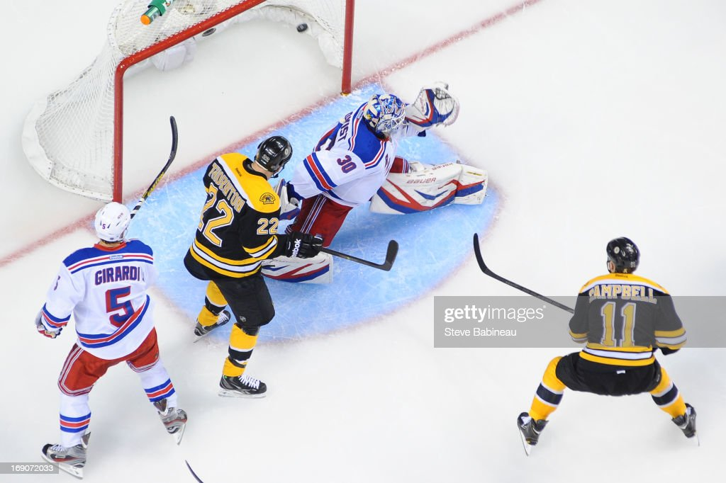 Gregory Campbell of the Boston Bruins scores a goal against Henrik Lundqvist of the New York Rangers in Game Two of the Eastern Conference Semifinals...