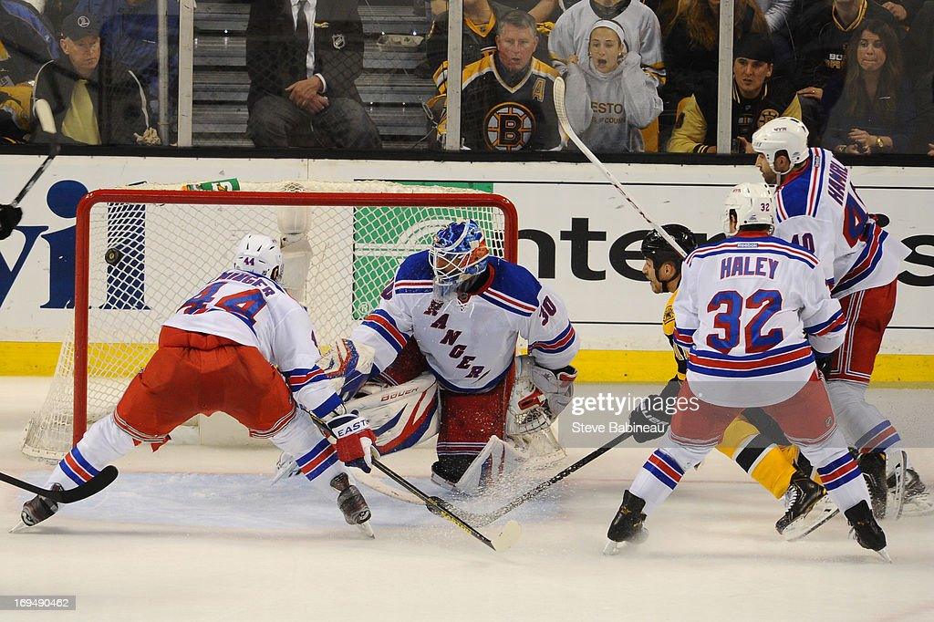 Gregory Campbell #11 of the Boston Bruins scores a goal against Henrik Lundqvist #30 of the New York Rangers in Game Five of the Eastern Conference Semifinals during the 2013 NHL Stanley Cup Playoffs at TD Garden on May 25, 2013 in Boston, Massachusetts.