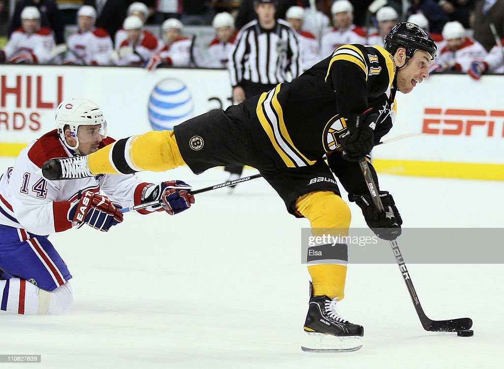 Gregory Campbell of the Boston Bruins scores an unassisted shorthanded goal in the third period as Tomas Plekanec of the Montreal Canadiens defends...