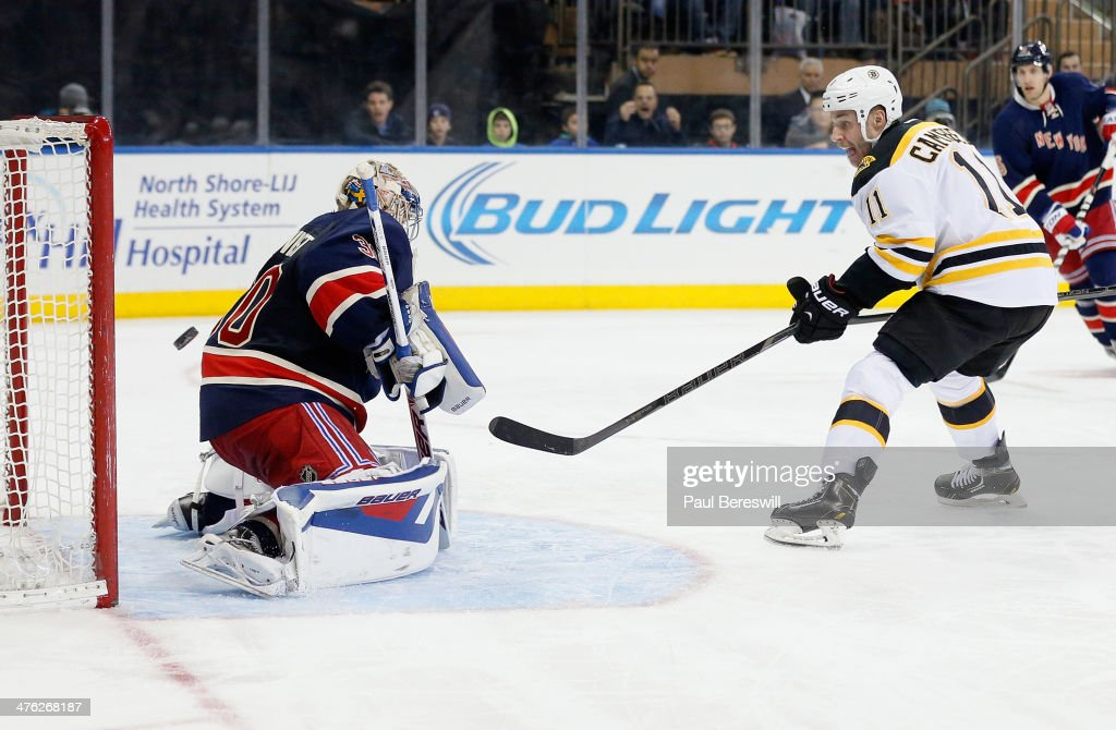 Gregory Campbell of the Boston Bruins shoots the puck past goalie Henrik Lundqvist of the New York Rangers for a goal during the third period of an...