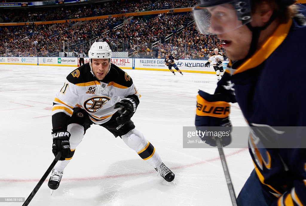 <a gi-track='captionPersonalityLinkClicked' href=/galleries/search?phrase=Gregory+Campbell&family=editorial&specificpeople=640895 ng-click='$event.stopPropagation()'>Gregory Campbell</a> #11 of the Boston Bruins skates in on Johan Larsson #22 of the Buffalo Sabres at First Niagara Center on October 23, 2013 in Buffalo, New York.