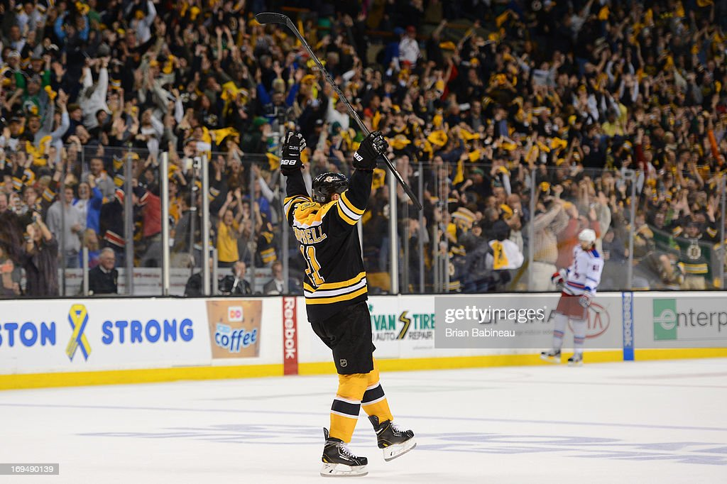 Gregory Campbell #11 of the Boston Bruins throws his arms up in the air after scoring an empty net goal against the New York Rangers in Game Five of the Eastern Conference Semifinals during the 2013 NHL Stanley Cup Playoffs at TD Garden on May 25, 2013 in Boston, Massachusetts.