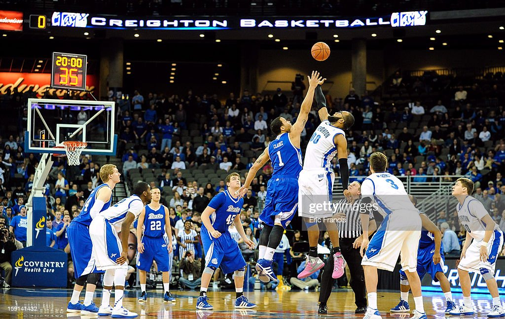 <a gi-track='captionPersonalityLinkClicked' href=/galleries/search?phrase=Gregory+Echenique&family=editorial&specificpeople=5648736 ng-click='$event.stopPropagation()'>Gregory Echenique</a> #00 of the Creighton Bluejays and Jordan Clarke #1 of the Drake Bulldogs vie for the tip off during their game at the CenturyLink Center on January 8, 2013 in Omaha, Nebraska.
