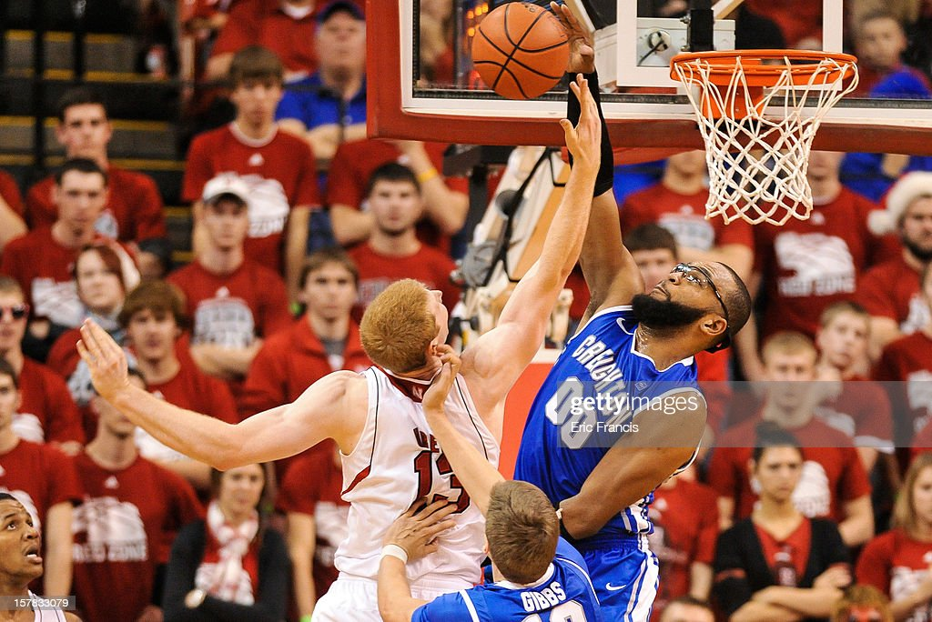 Gregory Echenique of the Creighton Bluejays blocks the shot of Brandon Ubel of the Nebraska Cornhuskers during their game at the Devaney Center on...