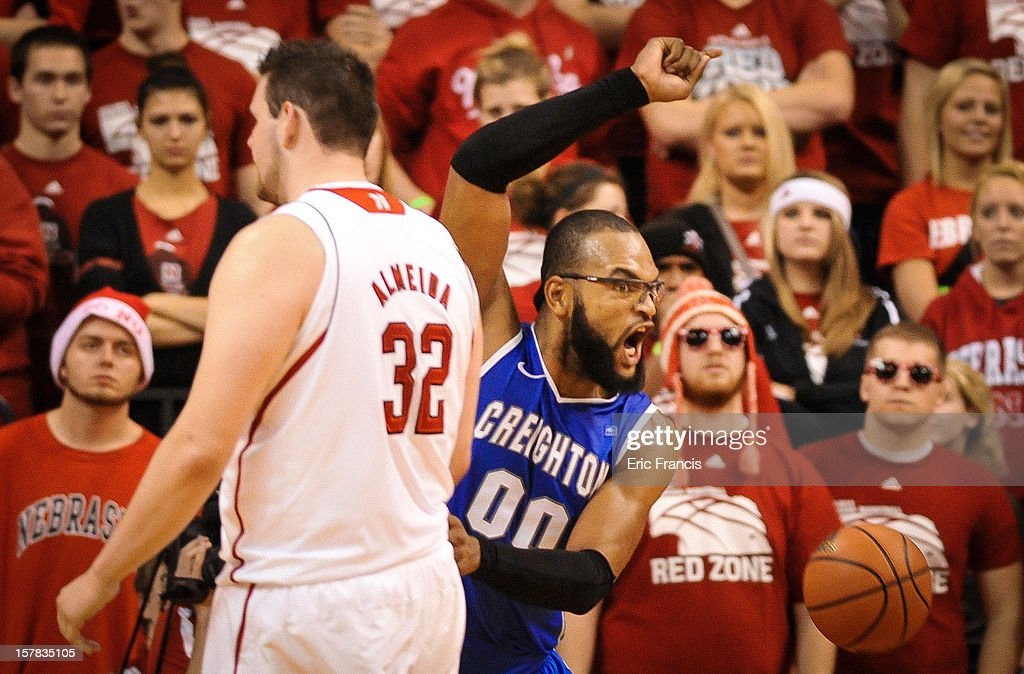 Gregory Echenique #0 of the Creighton Bluejays celebrates a basket over Andre Almeida #32 of the Nebraska Cornhuskers during their game at the Devaney Center on December 6, 2012 in Lincoln, Nebraska. Creighton defeated Nebraska 64-42.