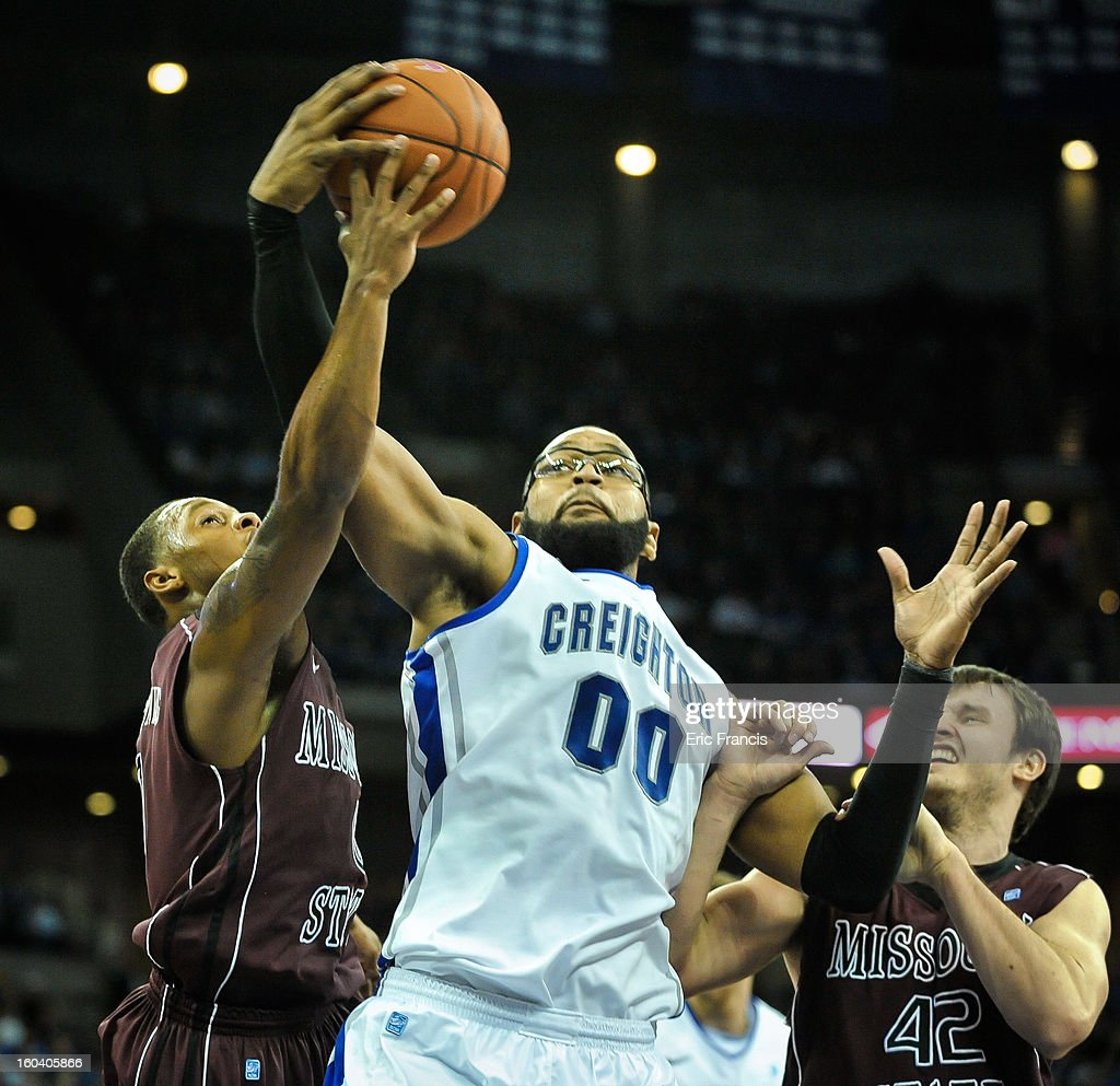 Gregory Echenique #0 of the Creighton Bluejays fights for a rebound with Christian Kirk #42 and Anthony Downing #0 of the Missouri State Bears during their game at the CenturyLink Center on January 30, 2013 in Omaha, Nebraska. Creighton defeated Missouri State 91-77.