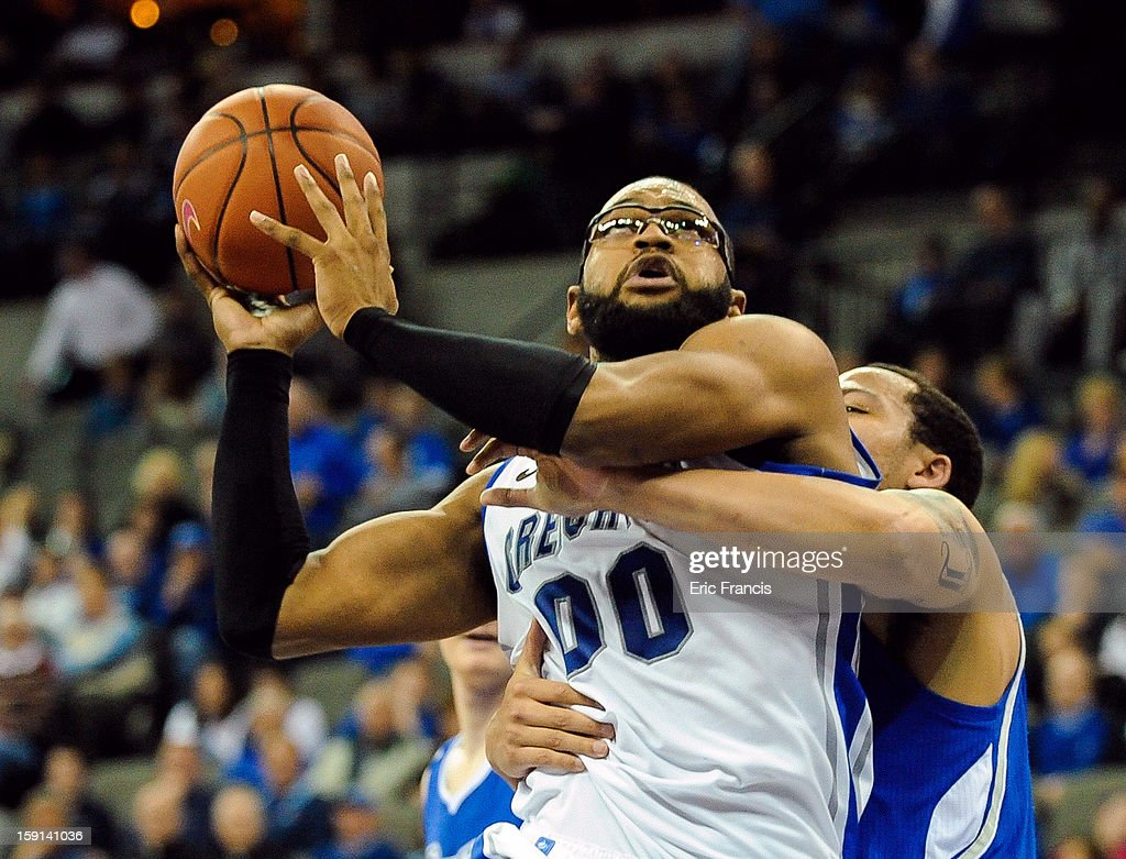 <a gi-track='captionPersonalityLinkClicked' href=/galleries/search?phrase=Gregory+Echenique&family=editorial&specificpeople=5648736 ng-click='$event.stopPropagation()'>Gregory Echenique</a> #00 of the Creighton Bluejays is fouled by Jordan Clarke #1 of the Drake Bulldogs during their game at the CenturyLink Center on January 8, 2013 in Omaha, Nebraska. Creighton defeated Drake 91-61.