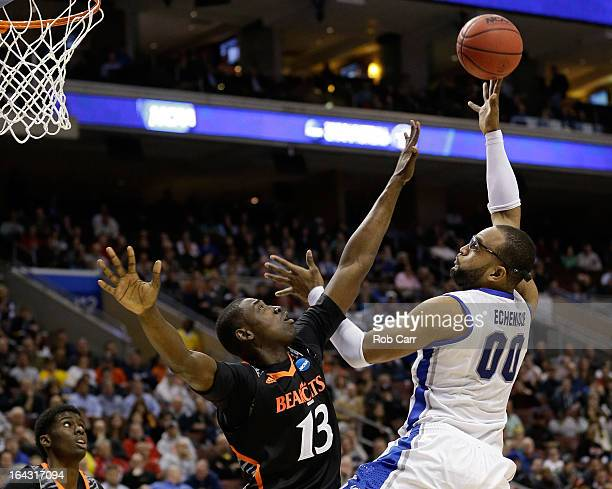 Gregory Echenique of the Creighton Bluejays looks to shoot against Cheikh Mbodj of the Cincinnati Bearcats in the second half during the second round...