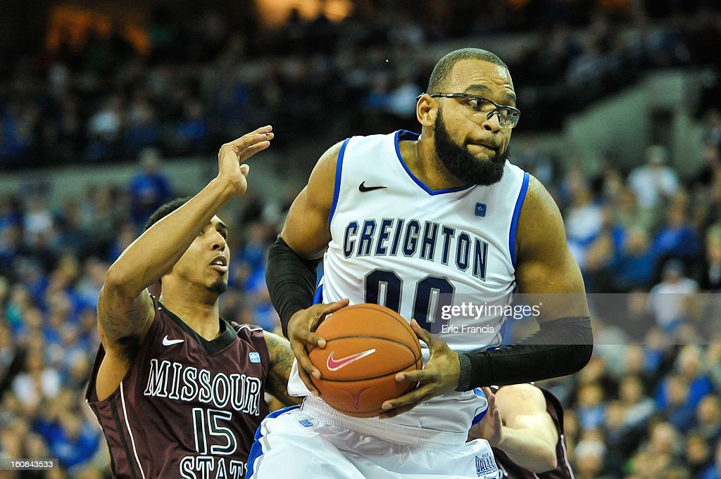 <a gi-track='captionPersonalityLinkClicked' href=/galleries/search?phrase=Gregory+Echenique&family=editorial&specificpeople=5648736 ng-click='$event.stopPropagation()'>Gregory Echenique</a> #00 of the Creighton Bluejays moves past Drew Wilson #15 of the Missouri State Bears during their game at the CenturyLink Center on January 30, 2013 in Omaha, Nebraska.