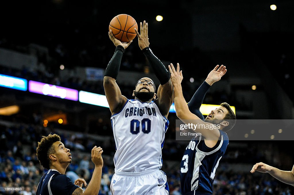 Gregory Echenique #0 of the Creighton Bluejays presses a shot between Nik Brown #1 and David Robinson #13 of the Longwood Lancers during their game at CenturyLink Center on November 20, 2012 in Omaha, Nebraska.