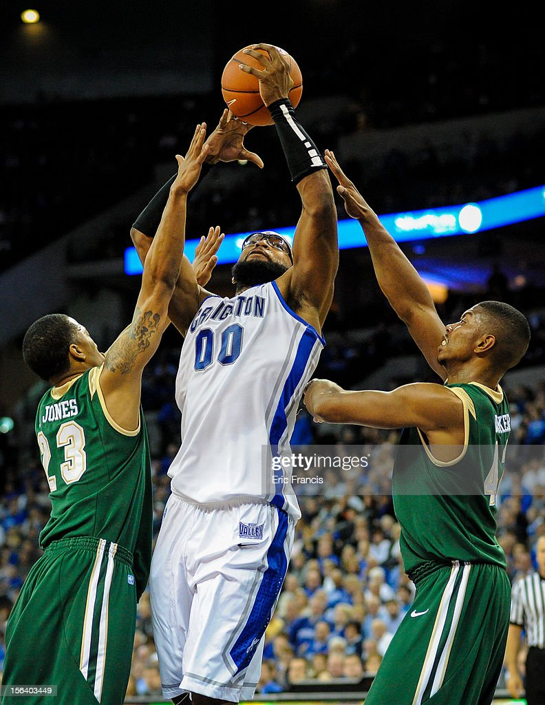 Gregory Echenique #0 of the Creighton Bluejays puts up a shot over Isiah Jones #23 and Rod Rucker #42 of the UAB Blazers during their game at CenturyLink Center on November 14, 2012 in Omaha, Nebraska.