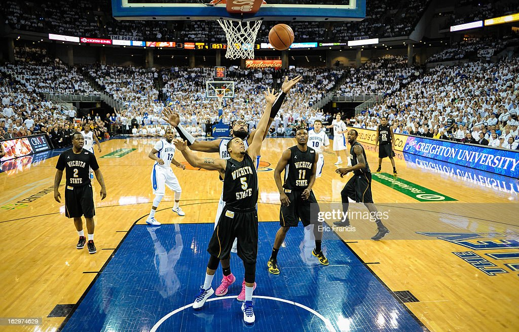 <a gi-track='captionPersonalityLinkClicked' href=/galleries/search?phrase=Gregory+Echenique&family=editorial&specificpeople=5648736 ng-click='$event.stopPropagation()'>Gregory Echenique</a> #00 of the Creighton Bluejays reaches over Demetric Williams #5 of the Wichita State Shockers during their game at the CenturyLink Center on March 2, 2013 in Omaha, Nebraska.