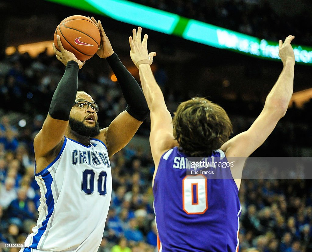 Gregory Echenique #0 of the Creighton Bluejays shoots over Ryan Sawvell #0 of the Evansville Aces during their game at the CenturyLink Center on December 29, 2012 in Omaha, Nebraska. Creighton defeated Evansville 87-70.
