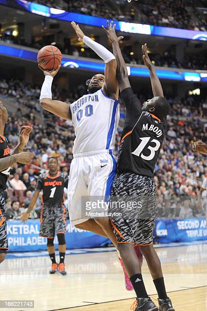 Gregory Echenique of the Creighton Bluejays takes a shot over Cheikh Mbodj of the Cincinnati Bearcats during the second round of the 2013 NCAA Men's...