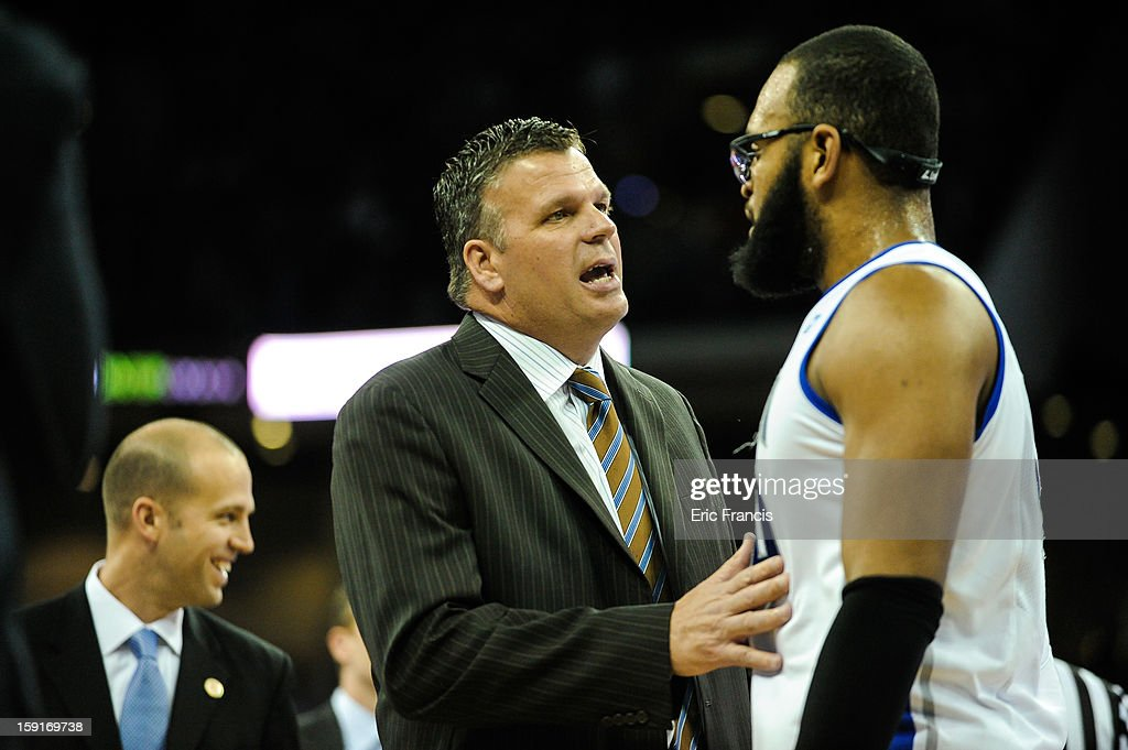 Gregory Echenique #00 of the Creighton Bluejays talks with head coach Greg McDermott of the Creighton Bluejays during their game at the CenturyLink Center on January 8, 2013 in Omaha, Nebraska. Creighton defeated Drake 91-61.