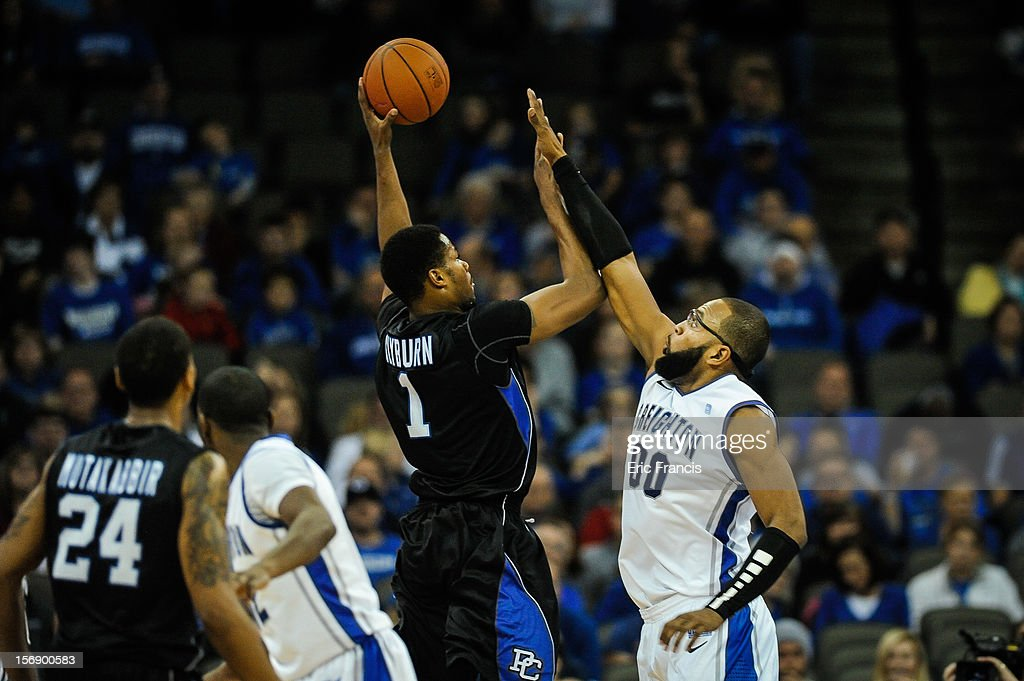 Gregory Echenique #0 of the Creighton Bluejays tries to block the shot of Joshua Clyburn #1 of the Presbyterian Blue Hose during their game at CenturyLink Center on November 18, 2012 in Omaha, Nebraska.