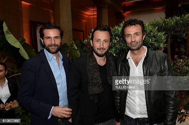 Gregory Fitoussi Michael Cohen and Victor Robert pose for Paris Match in the brazilian party at the Hotel Prince de Galles on june 29 2016 in Paris...