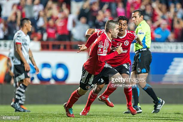 Gregory Garza of Xolos celebrates with Alfredo Moreno of Xolos after scoring the opening goal during a match between Tijuana and Atlas as part of...