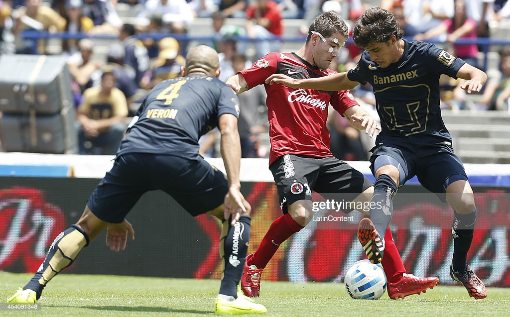 Gregory Garza of Xolos of Tijuana fights for the ball whit Jose Carlos Van Rankin of Pumas UNAM during a match between Pumas UNAM and Xolos Tijuana as part of 6th round Apertura 2014 Liga MX at Olimpic Stadium on August 24, 2014 in Mexico City, Mexico.