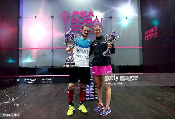 Gregory Gaultier of France and Laura Massaro of England pose with the winners trophys after the PSA Dubai World Series Finals 2016 at Burj Park on...
