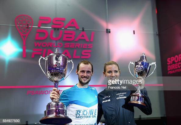 Gregory Gaultier of France and Laura Massaro of England pose with the winners trophys after PSA Dubai World Series Finals 2016 at Burj Park on May 28...