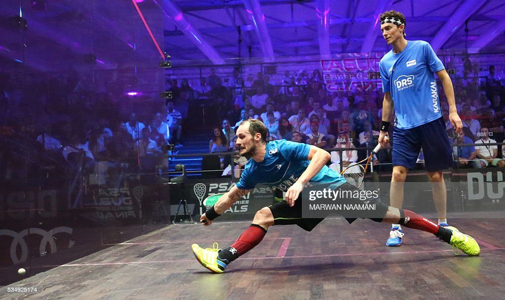 Gregory Gaultier (L) of France plays a forehand to Cameron Pilley of Australia in the men's final match of the Dubai PSA World Series Finals squash tournament in Dubai, on May 28, 2016. / AFP / MARWAN
