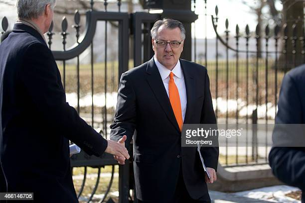 Gregory 'Greg' Brown chairman and chief executive officer of Motorola Solutions Inc center leaves the White House following a meeting with US...