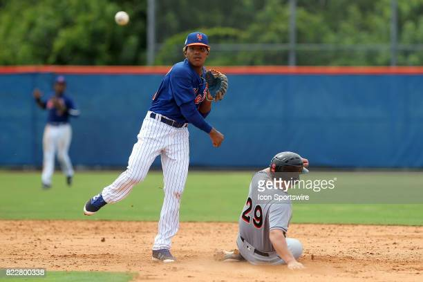 Gregory Guerrero of the Mets forces out JD Osborne of the Marlins and then makes the throw over to first base to complete the double play during the...