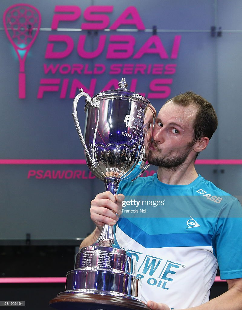 Gregory Guiltier of France holds the trophy after defeating Cameron Pilley of Australia during the men's final match of the PSA Dubai World Series Finals 2016 at Burj Park on May 28, 2016 in Dubai, United Arab Emirates.