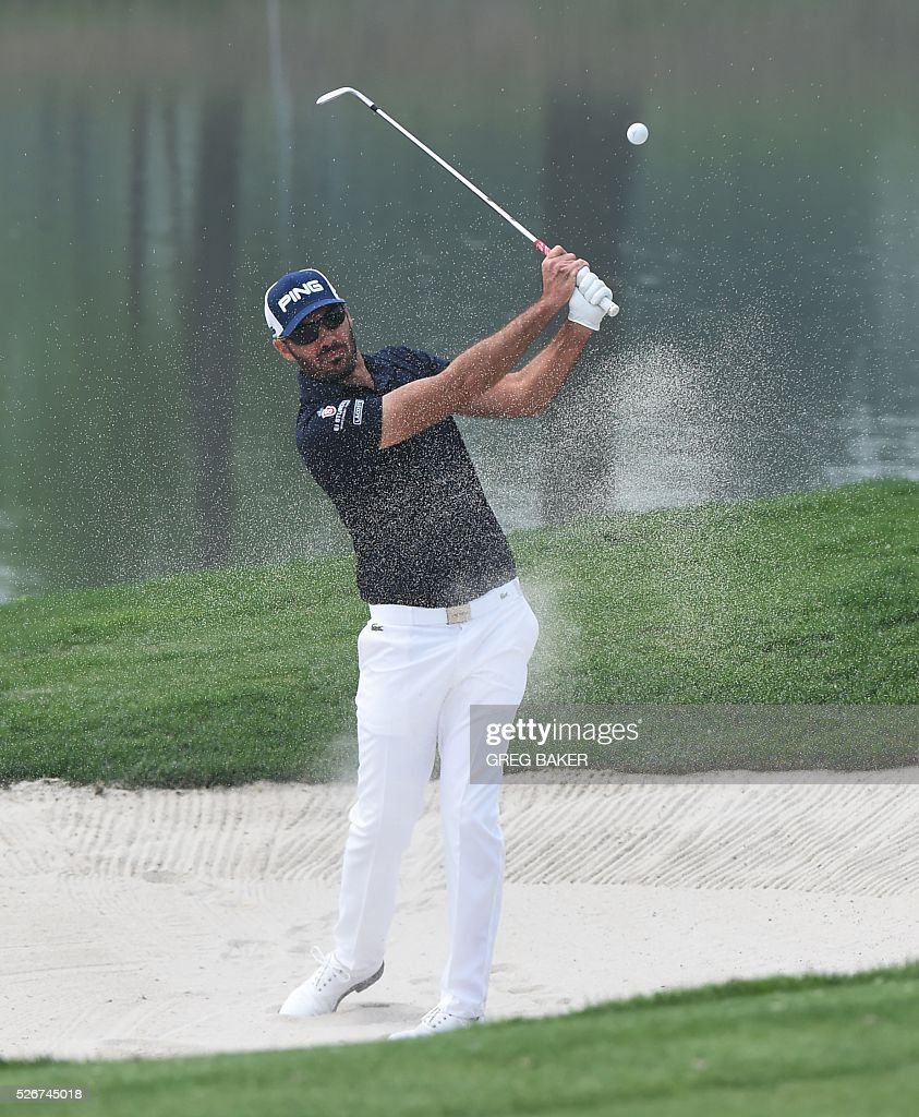 Gregory Havret of France hits a shot during the final round of the Volvo China Open golf tournament in Beijing on May 1, 2016. / AFP / GREG