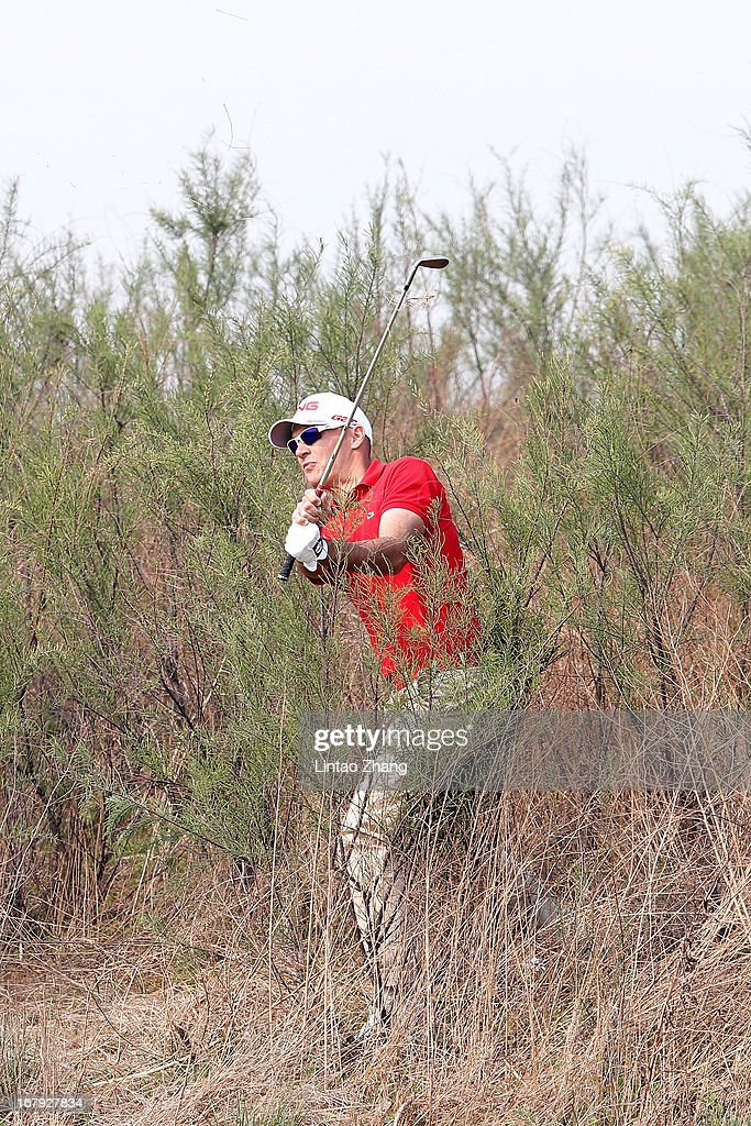 Gregory Havret of France plays a shot during the first day of the Volvo China Open at Binhai Lake Golf Course on May 2, 2013 in Tianjin, China.