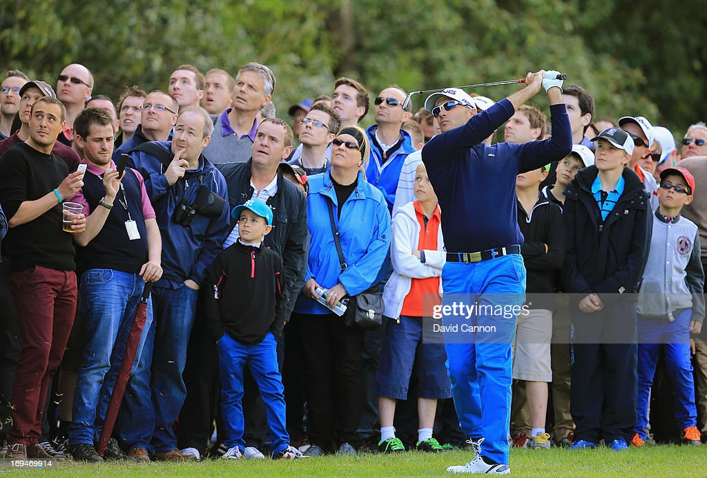 <a gi-track='captionPersonalityLinkClicked' href=/galleries/search?phrase=Gregory+Havret&family=editorial&specificpeople=211168 ng-click='$event.stopPropagation()'>Gregory Havret</a> of France plays his second shot on the eighteenth hole during the third round of the BMW PGA Championship on the West Course at Wentworth on May 25, 2013 in Virginia Water, England.
