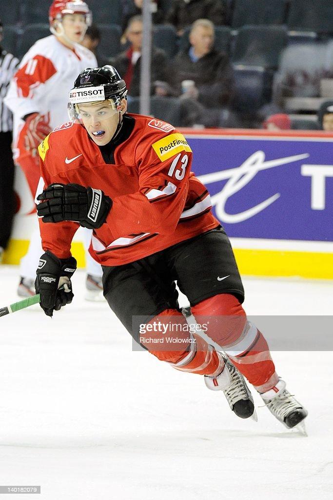 Gregory Hofmann #13 of Team Switzerland skates during the 2012 World Junior Hockey Championship game against Team Denmark at the Saddledome on January 2, 2012 in Calgary, Alberta, Canada.
