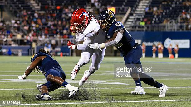 Gregory Howell Jr #9 of the Florida Atlantic Owls in action against Treyvon Williams of the FIU Panthers during the first half of the game at FIU...
