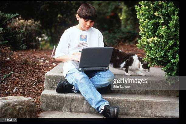Gregory Miller president of Tenadar uses a laptop computer March 15 1997 in San Francisco CA Since the beginning of the 1990s San Francisco has...
