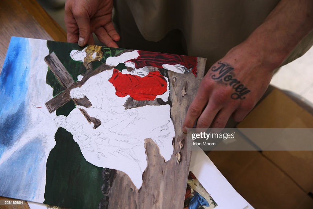 Gregory Orton former US Army Pvt shows off artwork in progress while serving a prison sentence at the military Veterans Unit of the Cybulski...