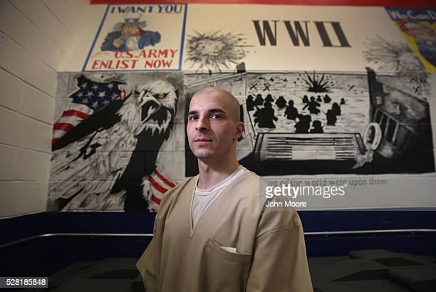 Gregory Orton former US Army Pvt stands in front of murals he painted while serving a prison sentence at the military Veterans Unit of the Cybulski...