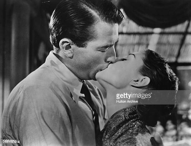 Gregory Peck and Audrey Hepburn kissing in the film 'Roman Holiday' directed by William Wyler