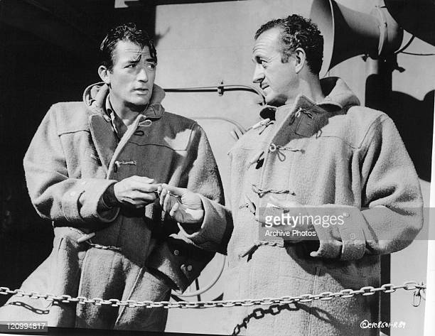 Gregory Peck and David Niven having a smoke in a scene from the film 'The Guns Of Navarone' 1966
