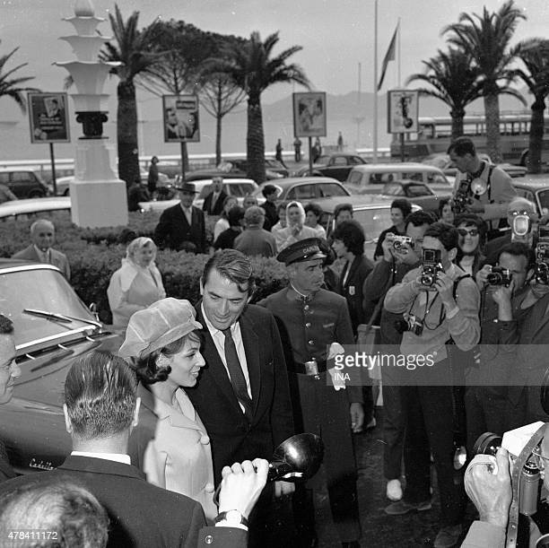 Gregory Peck and his wife on Croisette in the Cannes film festival