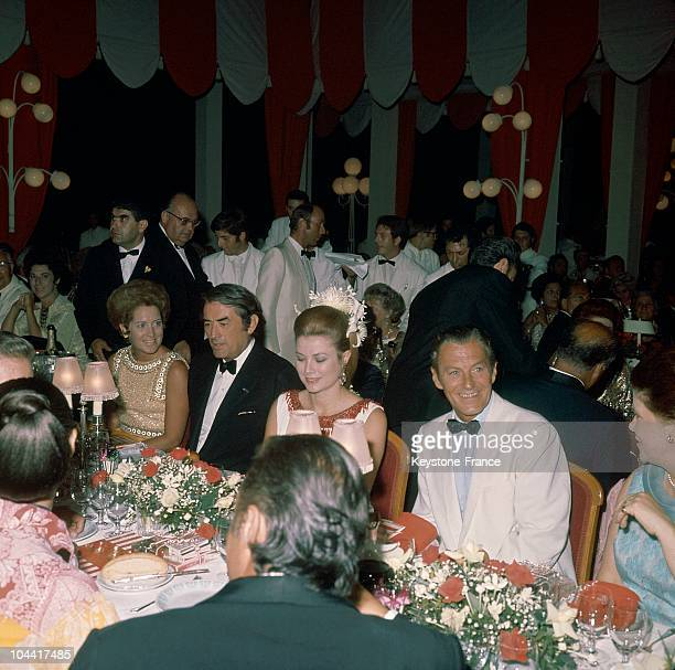 Gregory Peck and Princess Grace of Monaco having dinner at the Red Cross Ball in Monaco in 1970