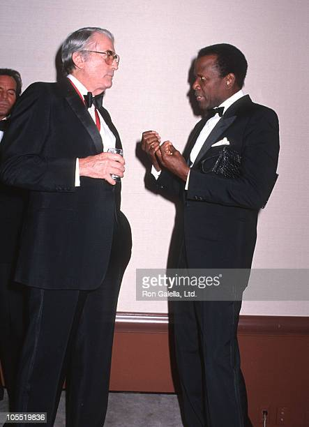 Gregory Peck and Sidney Poitier during Johnny Carson Gala at Beverly Hilton Hotel in Beverly Hills California United States