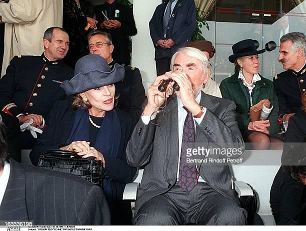 Gregory Peck and wife Bettina Graziani at The Arc De Triomphe Grand Prix In Paris