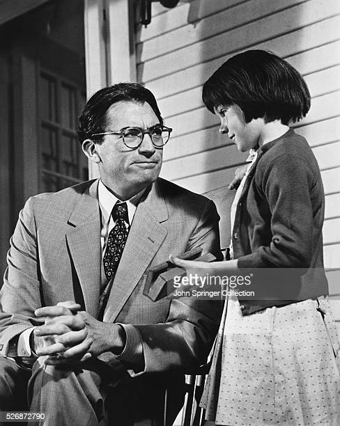 Gregory Peck as Atticus Finch and Mary Badham as Scout Finch in the 1962 film version of Harper Lee's To Kill a Mockingbird
